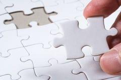 Weißes leeres Puzzle, Geschäftskonzept der Lösung Stockfotos