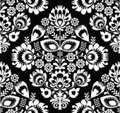 Weißes nahtloses Muster der polnischen Volkskunst auf schwarz- wzory lowickie, wycinanki Stockbilder