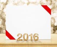 Weißes Plakat mit rotem Band und 2016-jährige hölzerne Beschaffenheit mit Badekurort Stockbild