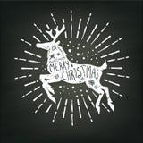 Weißes Schattenbild der Weihnachtsrotwild auf Kreidebretthintergrund Stockfoto