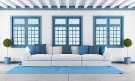 Weißes und blaues Wohnzimmer Stockfotografie