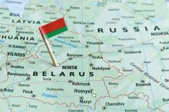 Weißrussland-Kartenflaggenstift Stockfotos