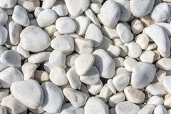 White decorative stones as a decorative floor design in the garden royalty free stock image