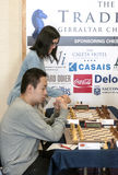 Wei Yi and Hou Yifan. Ju Wenjun and Hou Yifan professional chess player China, Playing chess tournament Gibraltar Tradewise Festival in January and February 2015 stock image