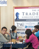 Wei Yi and Hou Yifan. Ju Wenjun and Hou Yifan professional chess player China, Playing chess tournament Gibraltar Tradewise Festival in January and February 2015 stock photos