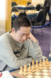 Wei Yi. Professional chess player China, Playing chess tournament Gibraltar Tradewise Festival in January and February 2015. It is an editorial image vertical Royalty Free Stock Photo