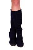 Weibliche Beine in den Stiefeln Lizenzfreies Stockfoto