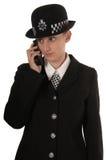 Weibliche BRITISCHE Polizeibeamte stockbild