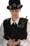 Weibliche BRITISCHE Polizeibeamte lizenzfreie stockfotografie