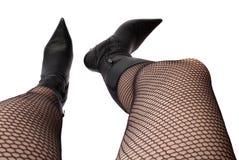 Weibliche Fahrwerkbeine geschossen von der Oberseite Lizenzfreies Stockfoto