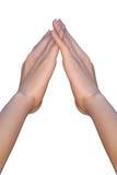 Weibliche Hände bilden eine Dreieckform, indem sie Finger berühren Stockfoto