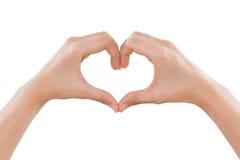 Weibliche Hände, die eine Herzform lokalisiert auf Weiß machen Stockbilder