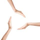 Weibliche Hände, die einen Kreis bilden Stockfotos