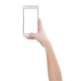 Weibliche Hände, die Foto mit intelligentem Telefon des leeren weißen Touch Screen, Vorderansicht, lokalisiert machen Lizenzfreies Stockfoto