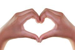 Weibliche Hände in Form von dem Herzen lokalisiert auf Weiß Stockfotos