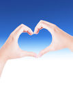 Weibliche Hände in Form von dem Herzen lokalisiert auf Weiß Lizenzfreie Stockbilder