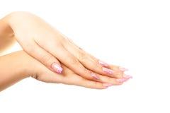 Weibliche Hand auf dem lokalisierten Hintergrund Lizenzfreie Stockbilder