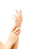 Weibliche Hand auf dem lokalisierten Hintergrund Stockfoto