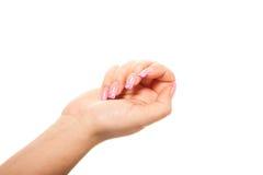 Weibliche Hand auf dem lokalisierten Hintergrund Stockfotos