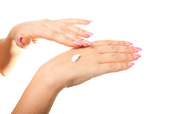 Weibliche Hand auf dem lokalisierten Hintergrund Lizenzfreies Stockfoto