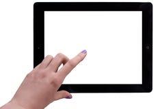 Weibliche Hand auf getrenntem Tablette-PC Stockfoto