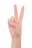 Weibliche Hand, die das Friedenszeichen lokalisiert auf Weiß zeigt Stockfotografie