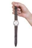 Weibliche Hand, die eine alte Uhr hält Stockfoto
