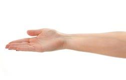 Weibliche Hand, die eine unsichtbare Nachricht anhält Lizenzfreie Stockfotografie