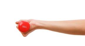 Weibliche Hand, die einen Dumbbell anhält Lizenzfreie Stockfotografie