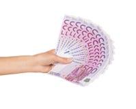 Weibliche Hand, die Geld hält Stockbilder