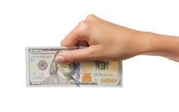 Weibliche Hand, die Gelddollar hält Stockfoto
