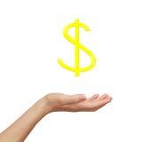 Weibliche Hand, die goldenen Dollar hält Lizenzfreies Stockfoto
