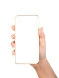 Weibliche Hand, die Goldhandy Smartphone hält Stockbild