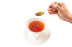 Weibliche Hand, die Honey With Tea II mischt Lizenzfreie Stockfotos