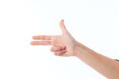 Weibliche Hand, die mit der Geste mit drei Fingern lokalisiert auf weißem Hintergrund darstellt Lizenzfreie Stockfotos