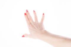Weibliche Hand, die Zeichen auf einem weißen Hintergrund zeigt Stockbild