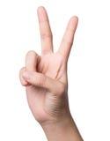 Weibliche Hand, die zwei Finger, auf weißem Hintergrund zeigt Lizenzfreie Stockbilder
