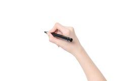 Weibliche Hand ist zum Zeichnen mit schwarzer Markierung betriebsbereit Stockfotografie