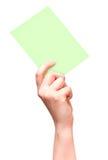 Weibliche Hand mit der Green Card getrennt auf Weiß stockfotografie