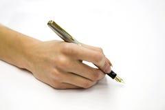 Weibliche Hand mit Feder Lizenzfreie Stockbilder
