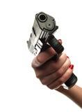 Weibliche Hand, welche die 9mm Pistole anhält Lizenzfreie Stockfotografie