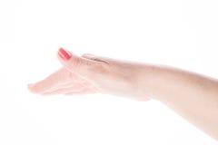 Weibliche Hand zeigt Zeichenhöhe auf einem Weiß Stockfotografie