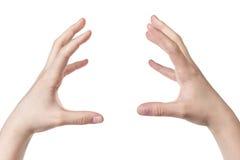 Weibliche jugendlich Hand, die unsichtbaren Bereich hält stockbild