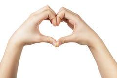 Weibliche jugendlich Hand macht Herzform mit den Händen Lizenzfreie Stockfotos