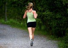 Weibliche Laufzeit stockbilder