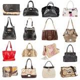 Weibliche lederne Handtaschen auf einem weißen Hintergrund Stockfoto