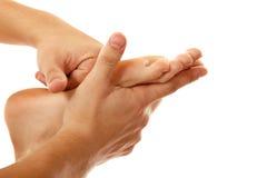 Weibliche Nahaufnahme des Massagefußes lokalisiert auf Weiß lizenzfreies stockbild