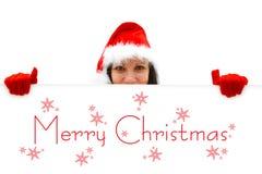 Weibliche Sankt, die frohe Weihnachten wünscht Lizenzfreie Stockfotografie