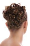 Weibliche stilvolle Haar-Nahaufnahme auf Weiß lizenzfreie stockbilder