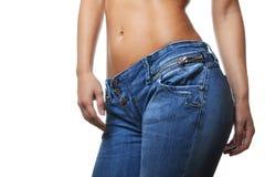 Weibliche tragende Jeans Lizenzfreie Stockfotos